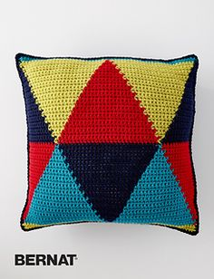 Graphic designs are a great way to incorporate color into your home - this triangular pillow is crocheted in four bright shades of Bernat Super Value, for maximum impact.