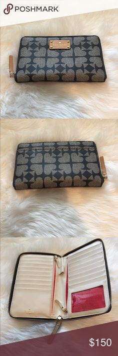 Kate Spade Travel Wallet Kate Spade Travel Wallet • Navy with Spade design • light tan interior • perfect condition • barely used • will consider all reasonable offers • if you have any questions feel free to let me know! • All items come from a clean smoke free home • No trades please! kate spade Accessories Key & Card Holders