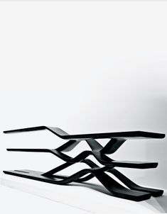 Second picture of same Zaha Hadid black granite shelving unit, from a different angle.
