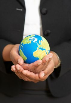 Business Woman Holding Small Globe Closeup Of Hands Stock Photo sb10069775n-001
