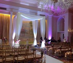 Tall #ivory #chuppah with uplighting at The Mayflower Hotel, Washington DC | www.bergeronsflowers.com