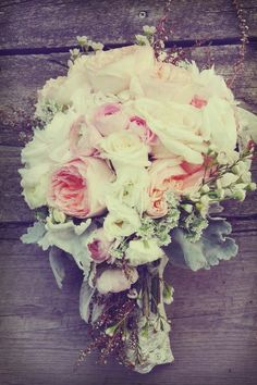 White and blush flowers, dusty miller, and maybe rosemary?