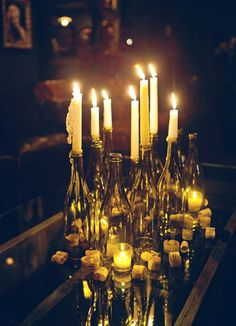 wine bottles with candles (I'd use twinkly lights), centerpiece for a speakeasy