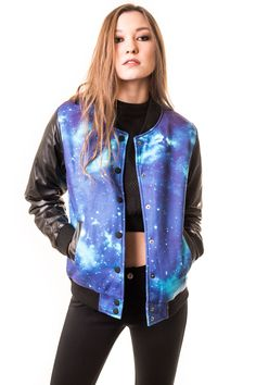 Fusing two of our favorite trends: athletic inspiration in eye catching prints, meet our faux leather galaxy bomber jacket. Featuring snap button closure in front, athletic cuffs, and two front pocket