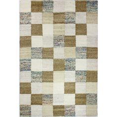 Anchor your living room seating group or define space in the den with this handmade wool and jute rug, featuring a patchwork motif in a neutral hue.