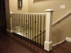 Antique white railing and post with black iron balusters that we built in a home in Salt Lake City Indoor Stair Railing, Wrought Iron Stair Railing, Iron Balusters, Staircase Railings, Staircase Design, Banisters, Staircases, Loft Railing, Railing Ideas