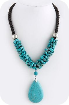 Rope necklace accented by a cluster of stones and beautiful teardrop focal accent.