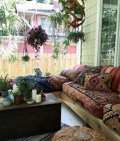 Summer style!! Modern Bohemian Chic style! Outdoor Porch with lots of comfy cushions and color and plants!