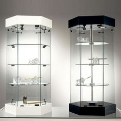 Base-Nova Revolving Showcases Base-Nova Revolving Showcases - 5 shelves in full-size showcases - 3 shelves in counter showcases, depth cm. 46 - door runners, designed with extra ridges, for safety - plexiglass anti-slamming washers - standard lock included. The showcases can be supplied with the following optionals, on request: - Lighting canopy, fitted with flat lamps, switch and electric cable with plug, all meeting international safety standards. - Metal tracks (CR), which allows the…