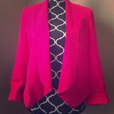 Bebe Hot Pink Blazer This is perfect for the office or for over your black dress for a holiday party. 100% polyester. Dry clean only. There's a stain on the inside that can not be seen by wearing it. Would probably be taken care of with a dry clean if it really bothered you. Back is shorter and front hangs down with no closure. bebe Jackets & Coats Blazers