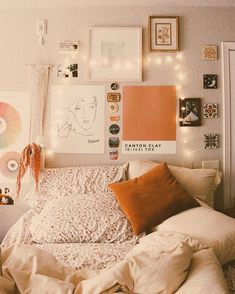 I like the color accents against the white and the patterned sheets under the white comforter!