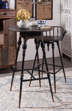 Crestly Metal Bar Table - Serve your guests in style with this traditional round metal bar table in a rustic black finish. Coordinate with Crestly metal bar.