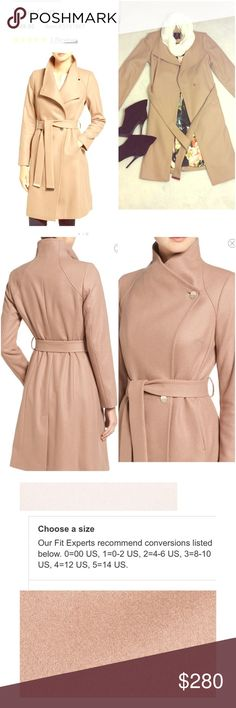 """NWOT Ted Baker London Wrap Coat Size 3 A touch of cashmere enhances the cozy feel of an elegant woolen wrap coat topped with draping, two-tone lapels and sparked with highly polished metal accents. 36"""" length (size 3) Side-seam pockets Matching belt Center vent 75% wool, 20% polyamide, 5% cashmere By Ted Baker London                                              Never worn the only thing i could find wrong is scratches on belt as shown. Thanks for looking God bless you! Ted Baker London…"""