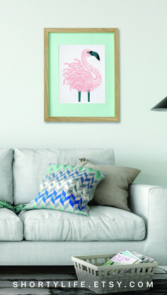 -Turn your living room into a tropical haven with a pink flamingo wall art print.