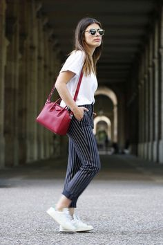 Cute office outfit ideas for a Casual Friday: pinstripe pants and a white short-sleeve top. Click for more!
