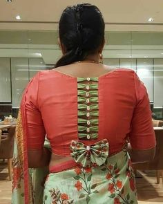 Best 12 Red floral blouse design with tassels detailing and button on back - Simple Blouse Designs, Stylish Blouse Design, Designer Blouse Patterns, Fancy Blouse Designs, Latest Blouse Designs, Dress Patterns, Sleeves Designs For Dresses, Blouse Back Neck Designs, Blouse Models