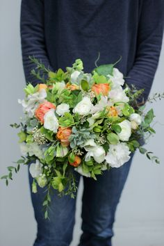 April bridal bouquet grown and designed by Love 'n Fresh Flowers.  White, peach, and green.