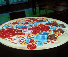 Interactive tables by GestureTek at the Richtree Natural Market food court in the Toronto Eaton Centre.