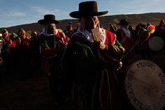 Aymara indigenous musicians play flutes and drums at dawn during a new years' ritual at the ruins of the ancient civilization of Tiwanaku, Bolivia. The Aymara Indians celebrate the year 5,520 as well as the southern hemisphere's winter solstice, marking the start of a new agricultural cycle.    Juan Karita/AP