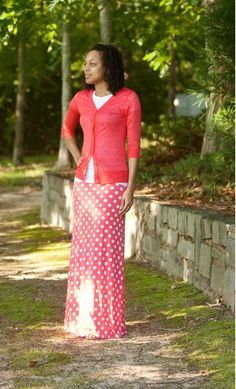 Womens modest long polka dot maxi skirt made from a silky and soft fabric with banded waist line worn with burnout cardigan.