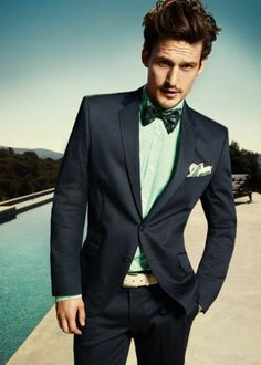 Mint shirt with teal accented tie and cream belt make this navy suit feel light and appropriate for summer. Smart!