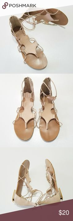 Aldo sandals Nude and gold tones. These will compliment a wide vatiety of outfits. Very stylish. These sandals were gently worn and are in good condition. Aldo Shoes Sandals