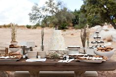 Wedding reception table set decoration with cactus, old wood, rustic and boho style in desert. Having your wedding in a desert = pure romanticism...