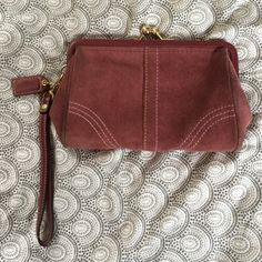 "Coach suede wristlet Adorable change purse-style wristlet from coach. Good condition, some mild wear and darkening along seams (see pictures). Mauve/purple with gold hardware. Measures 5"" x 8"" including closure. Coach Bags Clutches & Wristlets"