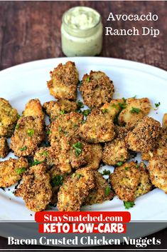Keto Low-Carb Bacon Parmesan Crusted Chicken Nuggets with Avocado Ranch dipping sauce is a quick and easy recipe perfect for tenders, strips, or chicken fingers. This dish is ketogenic, great for ketosis, family, and kid-friendly with only 3 grams of carbs per serving! Serve them baked or fried. #KetoRecipes #KetoDinner #KetoChickenNuggets
