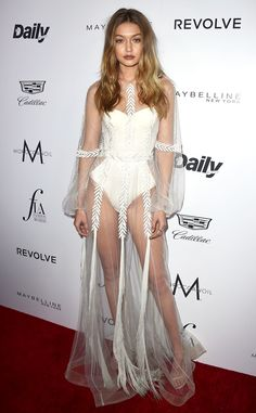 Gigi Hadid from Fashion Los Angeles Awards 2016: Best Looks  With her sister and mom on-hand for support, the supermodel turns heads in her sheer white outfit.