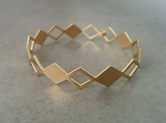 Geometric Bracelet, Gold Bracelet, Geometric Jewelry, Gold Geometric, Cuff Bracelet, Simple Bracelet, Bridesmaid Gift, Honeycomb Bracelet  Gold Geometric Cuff Bracelet, Made of 24k gold plated brass base.  Dimensions: Diameter: 2.5 inch 6 cm Width: 1.5 inch 4 cm Bracelet Total length 7.25inch / 18.5cm Fits wrist measurement 6.3inch/16cm to 7.1inch/18cm