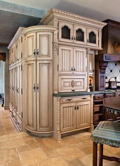 Home Renovation Remodeling Curved cabinets conceal a built-in water cooler; additional storage lockers lead to the family entrance and mudroom. Custom Kitchen Cabinets, Custom Kitchens, Luxury Kitchens, Home Kitchens, Kitchen Wood, Ivory Cabinets, Hickory Kitchen, Shaker Kitchen, Dark Cabinets