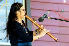 Flutist Migon Geli Performing for the crowd. Native American Flute, American Indians, Crowd, Culture, Country, Celebrities, Hair Styles, Music, Beauty