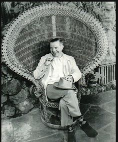 Vic Bergeron (Trader Vic) in the well-known peacock chair.