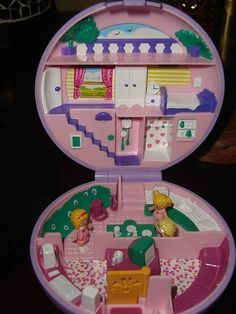POLLY POCKETS!!!!! Hahaha I loved this toy growing up!!!! Polly Pockets are now full sized dolls. How is that supposed to fit in your pocket?!