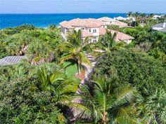 Majestic oceanfront home privately situated on almost 1 acre of beachfront. Panoramic ocean views, a chef's kitchen, 2 master suites, spacious living and dining rooms, media room, office, exercise room, elevator, & beautiful marble & wood floors. Oceanfront pool & spa surrounded by lovely grounds. Effective year built 2011. Amenities include tennis and clubhouse w/community pool.
