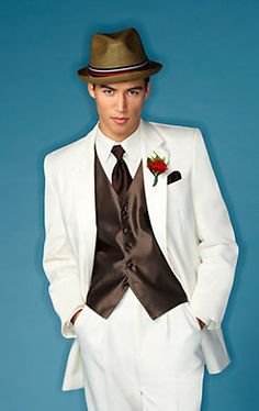 Pair a bright color with a Joseph & Feiss Ivory Two-Button Notch Lapel #tuxedo for a easy-going #wedding.