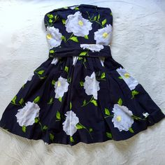 Floral Dress Navy strapless dress with white flowers. Tie into a bow in the back. Worn once. Abercrombie & Fitch Dresses Mini