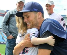 Tom Brady greets an Andruzzi Foundation beneficiary