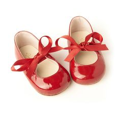 Red patent leather baby shoes with red ribbon bow