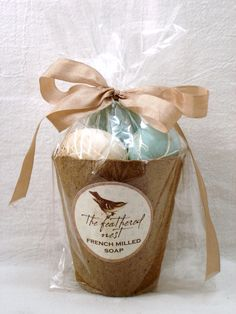 Beautiful MIXED speckled egg shaped soap packaged in a peat pot
