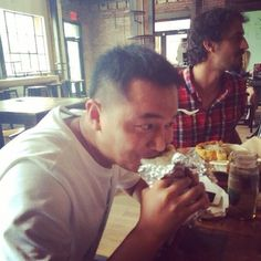 LiWei visits from Beijing and has his first burrito ...not quite sure he is a fan...yet!