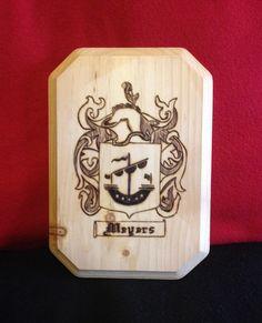 Woodburnt design family crest plaque.