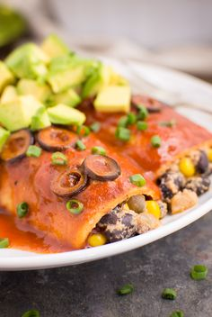 The best vegan enchiladas loaded with black beans, corn, and grilled onions mixed with a creamy sauce. They're easy to make and always satisfying. Black Bean Enchiladas, Vegan Enchiladas, Fall Recipes, Vegan Recipes, Mexican Food Recipes, Ethnic Recipes, Enchilada Sauce, Creamy Sauce, Vegan Dishes