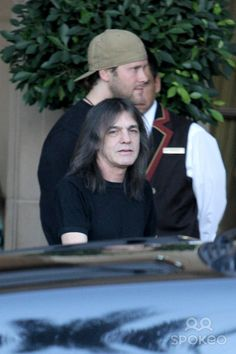 Malcolm Young of AC/DC departs his hotel before performing a live concert