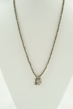 Add a little sparkle to your collection with this 3mm pyrite necklace with a unique cut out cross. Comes in sterling silver or bronze.