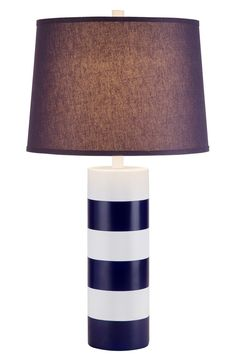 Stripes circle this eye-catching table lamp crafted in smooth resin and topped with a navy linen drum shade.