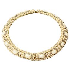 Gold-finished+choker+necklace+with+Austrian+crystals+and+faux+stones.+  Product:+NecklaceConstruction+Material:+Brass,...