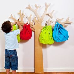 Fruut Tree storage system take root in their bedroom or playroom, the branches may help put an end to the chaos and clutter.  Made from FSC accredited plantation birch wood, you simply affix this giving tree to the wall, where it may collect toys, coats, play clothes, backpacks, hats, you name it.  The Fruut Tree could be a rotating art installation that changes with the seasons. Kids can decorate it for Christmas, Halloween, Easter, etc. to make their space festive!