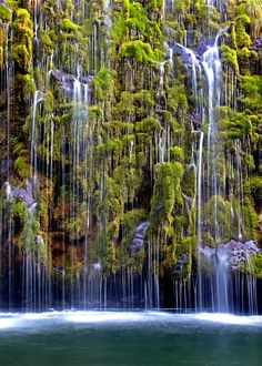 Mossbrae Falls is a waterfall flowing into the Sacramento River, in the Shasta Cascade area in Dunsmuir, California. Access to the falls is via a mile-long hiking trail on the Union Pacific Railroad tracks. Places To Travel, Places To See, Travel Destinations, Places Around The World, Around The Worlds, Photos Voyages, Beautiful Waterfalls, Adventure Is Out There, Vacation Spots